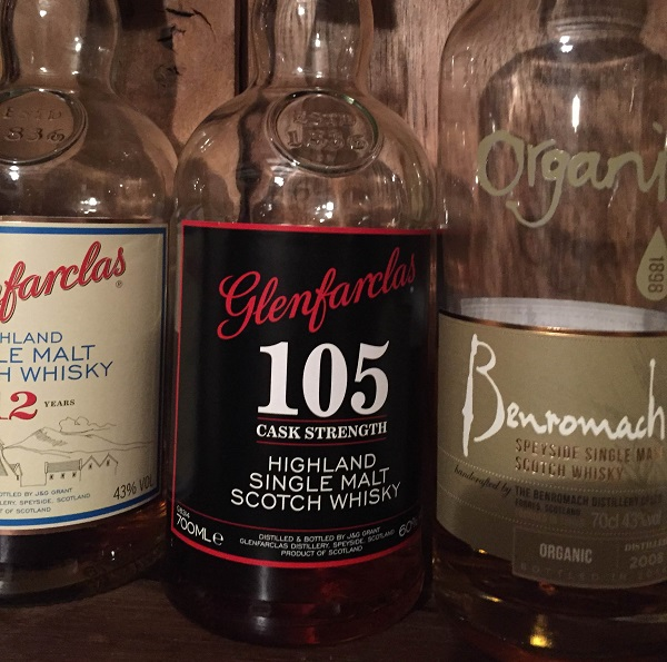 Glenfarclas 105 with brother Glenfarclas 12 on the left and an organic Benromach on the right